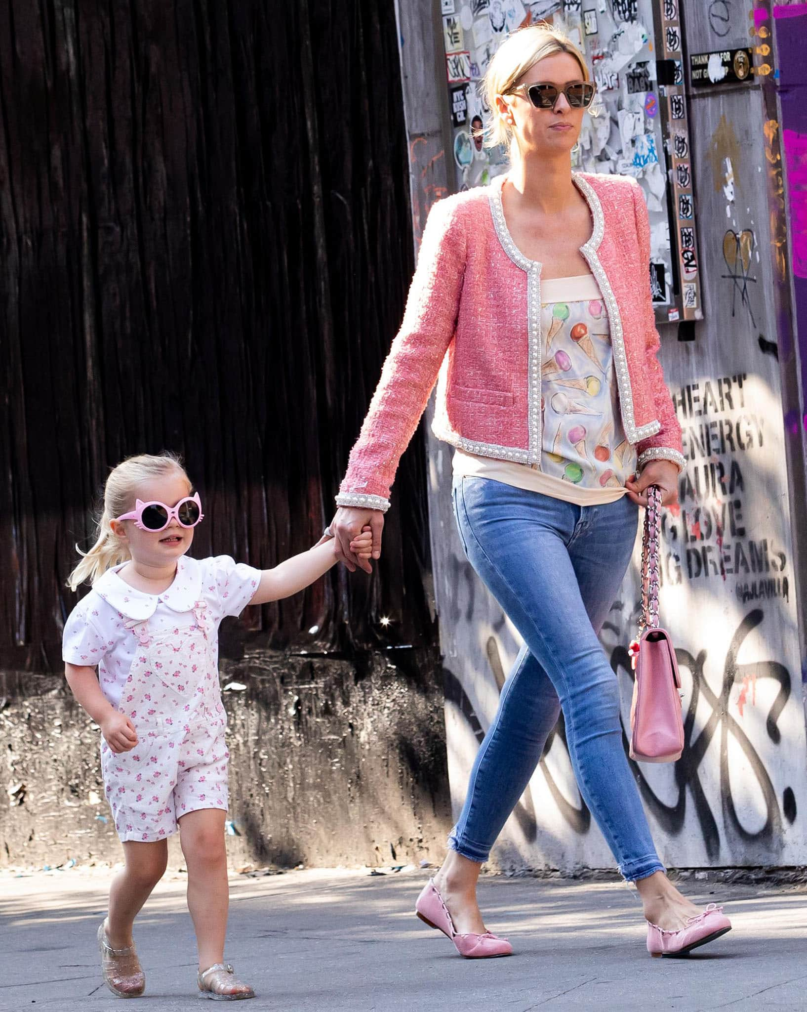 Nicky Hilton's youngest daughter Teddy wears floral overalls with a peter pan-collared blouse and jelly shoes