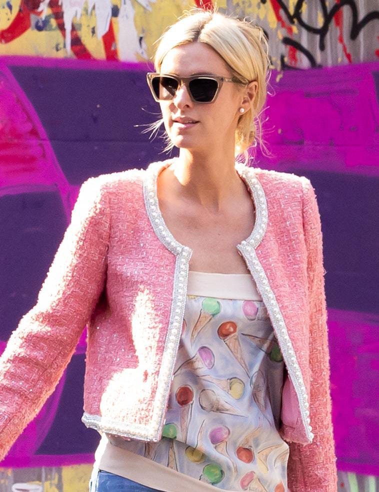 Nicky Hilton wears a low bun hairstyle and hides her blue eyes behind Illesteva sunglasses