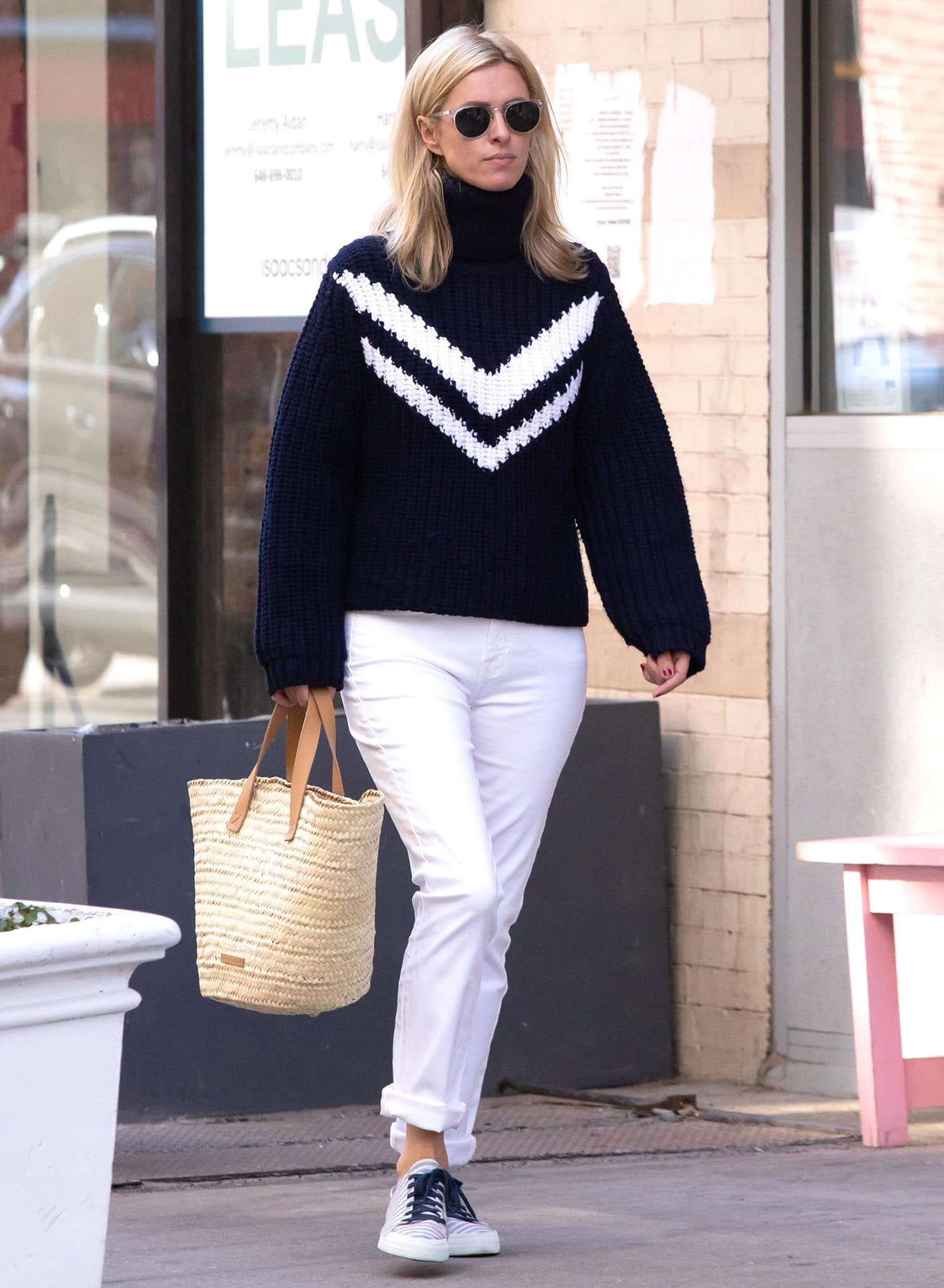 Nicky Hilton runs errands in Tory Burch chunky knit sweater and Jen7 white jeans on May 25, 2021