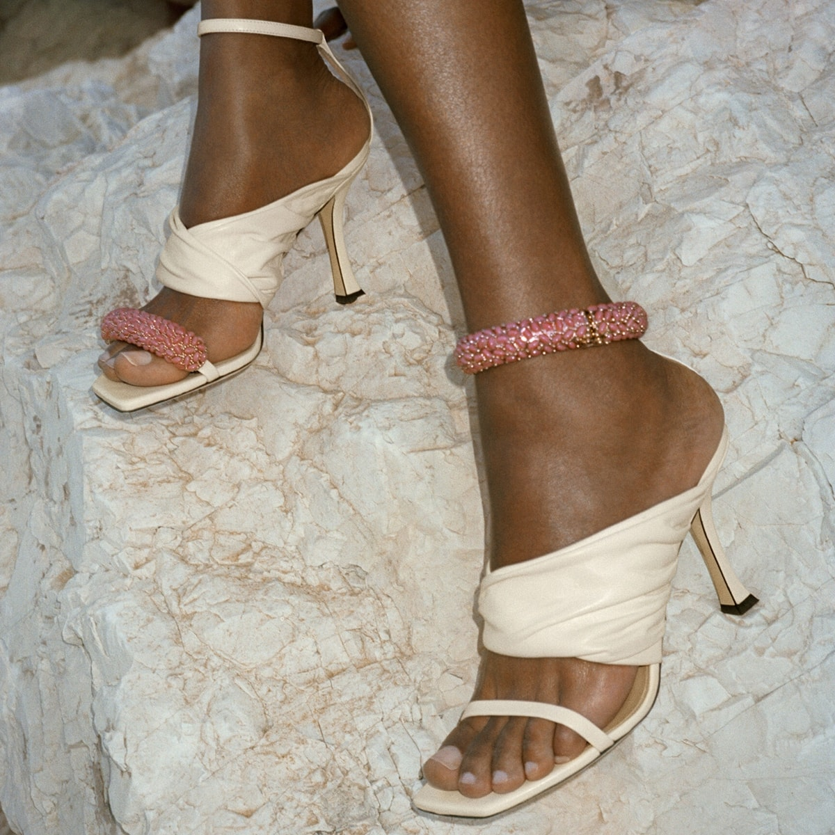 Jimmy Choo summer sandals featuring a light pink bracelet that is embellished with glass stones