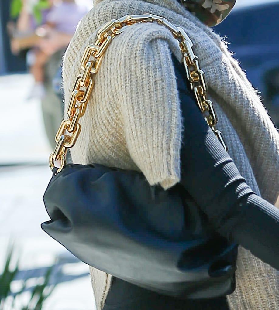 Olivia Culpo carries her essentials in Bottega Veneta The Pouch chain clutch
