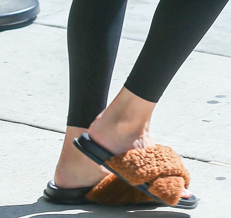 Olivia Culpo completes her chic athleisure with Topshop Harissa brown faux fur slide sandals