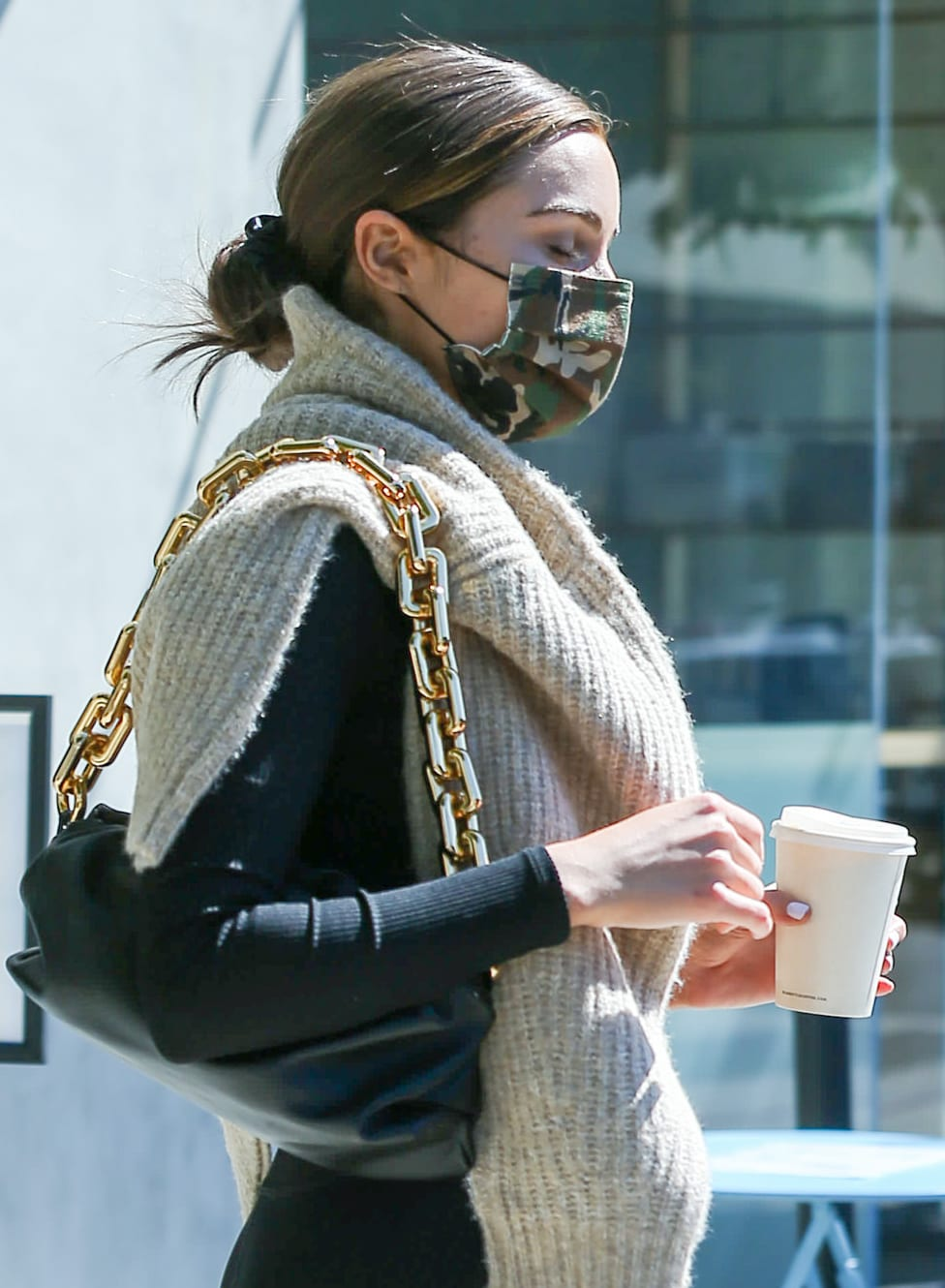 Olivia Culpo wears a camo face mask from her Together collection with Express
