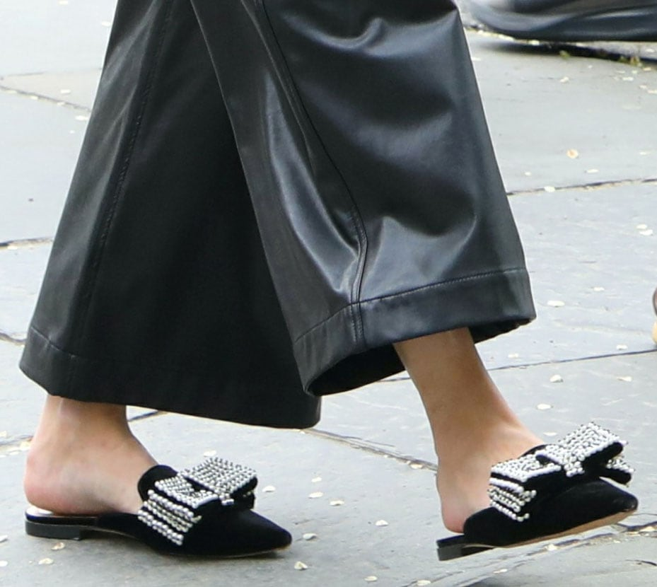 Olivia Palermo adds sparkles to her all black look with Alberta Ferretti embellished velvet mules