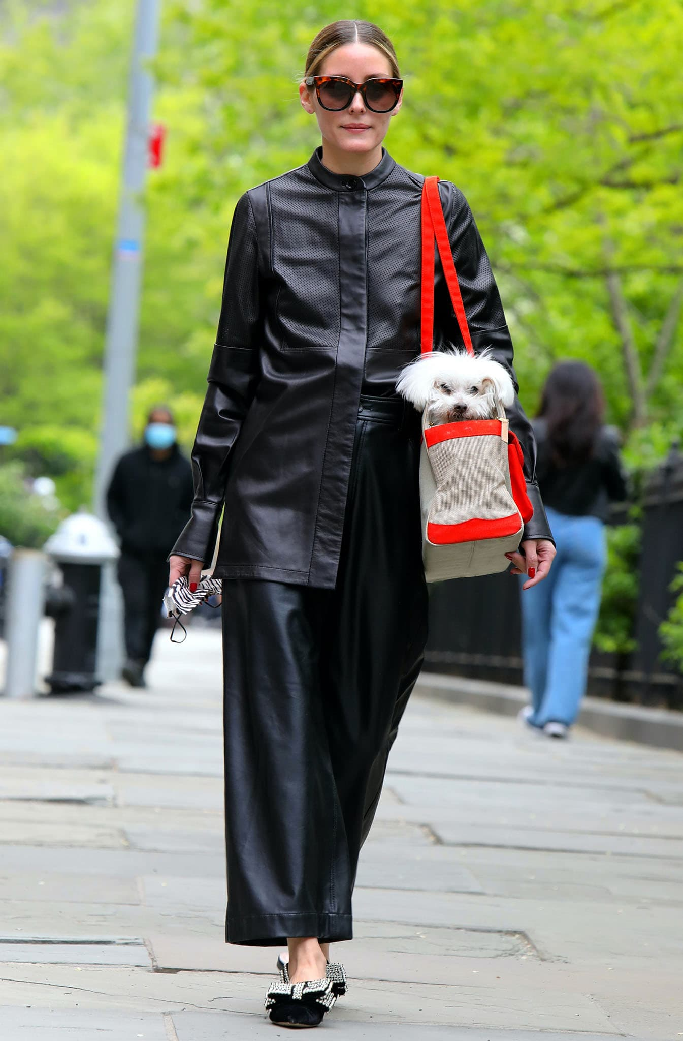 Olivia Palermo goes head-to-toe black in her perforated leather tunic and Tibi leather culottes