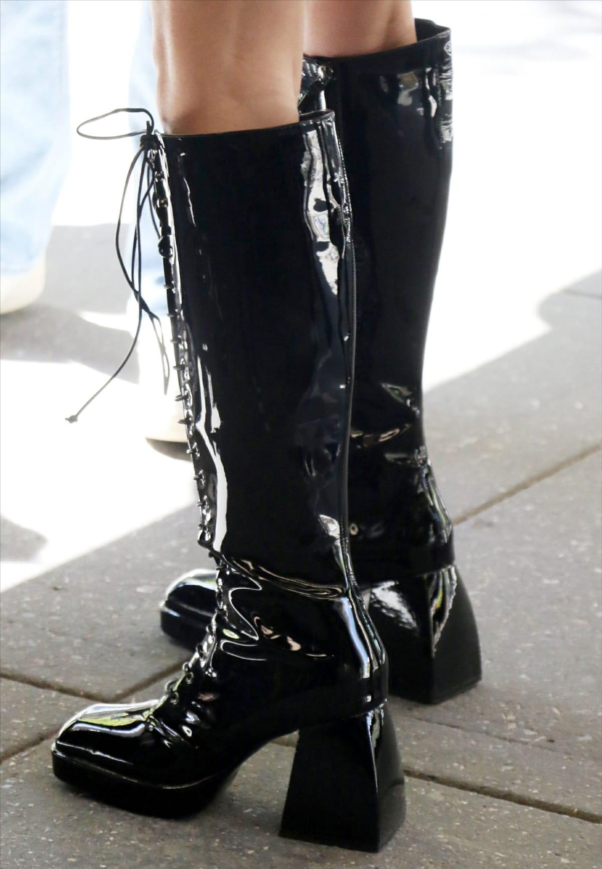Olivia Rodrigo rocked a chunky pair of knee-high PVC boots