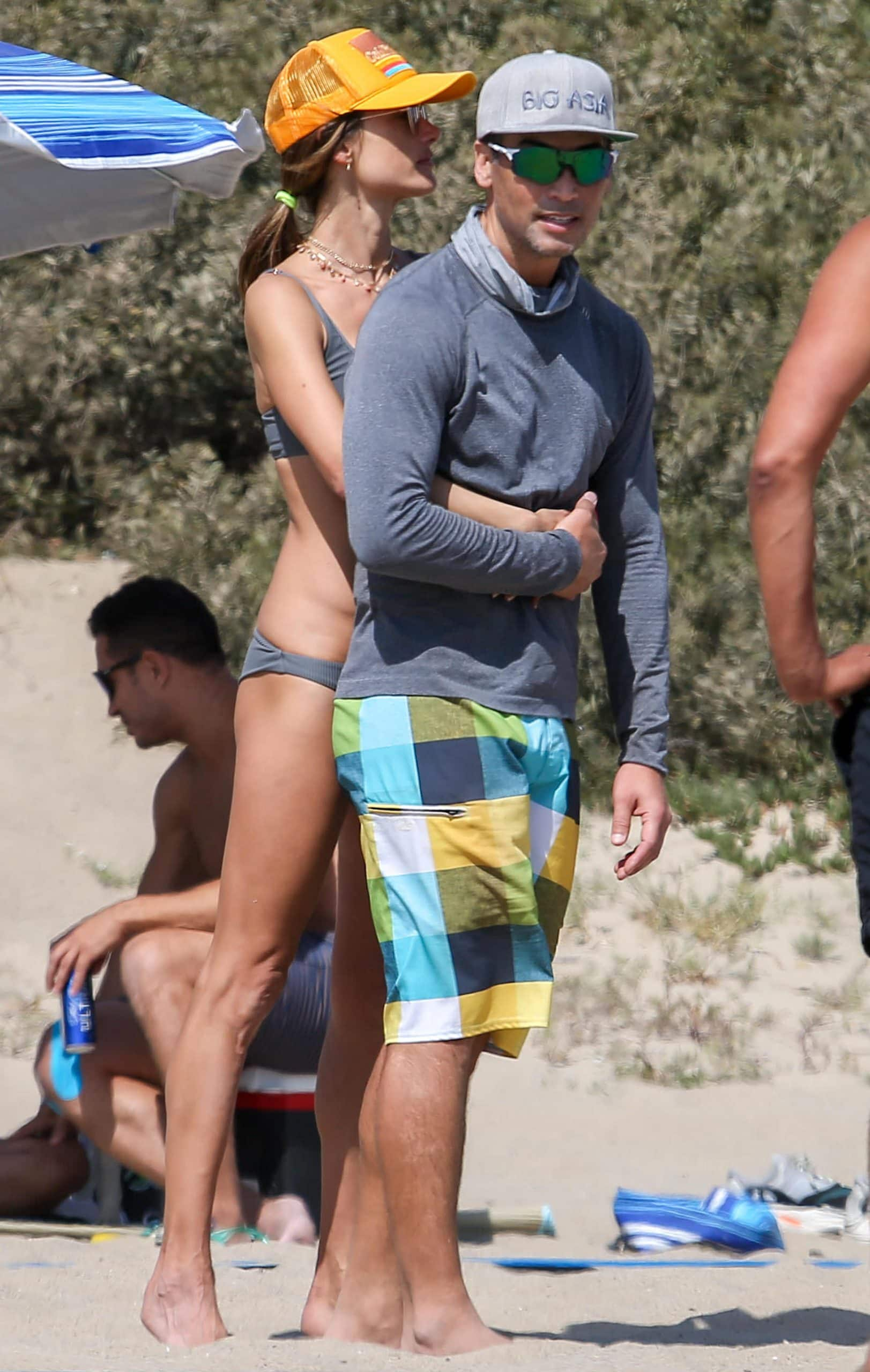 Alessandra Ambrosio hugs her boyfriend Richard Lee from behind