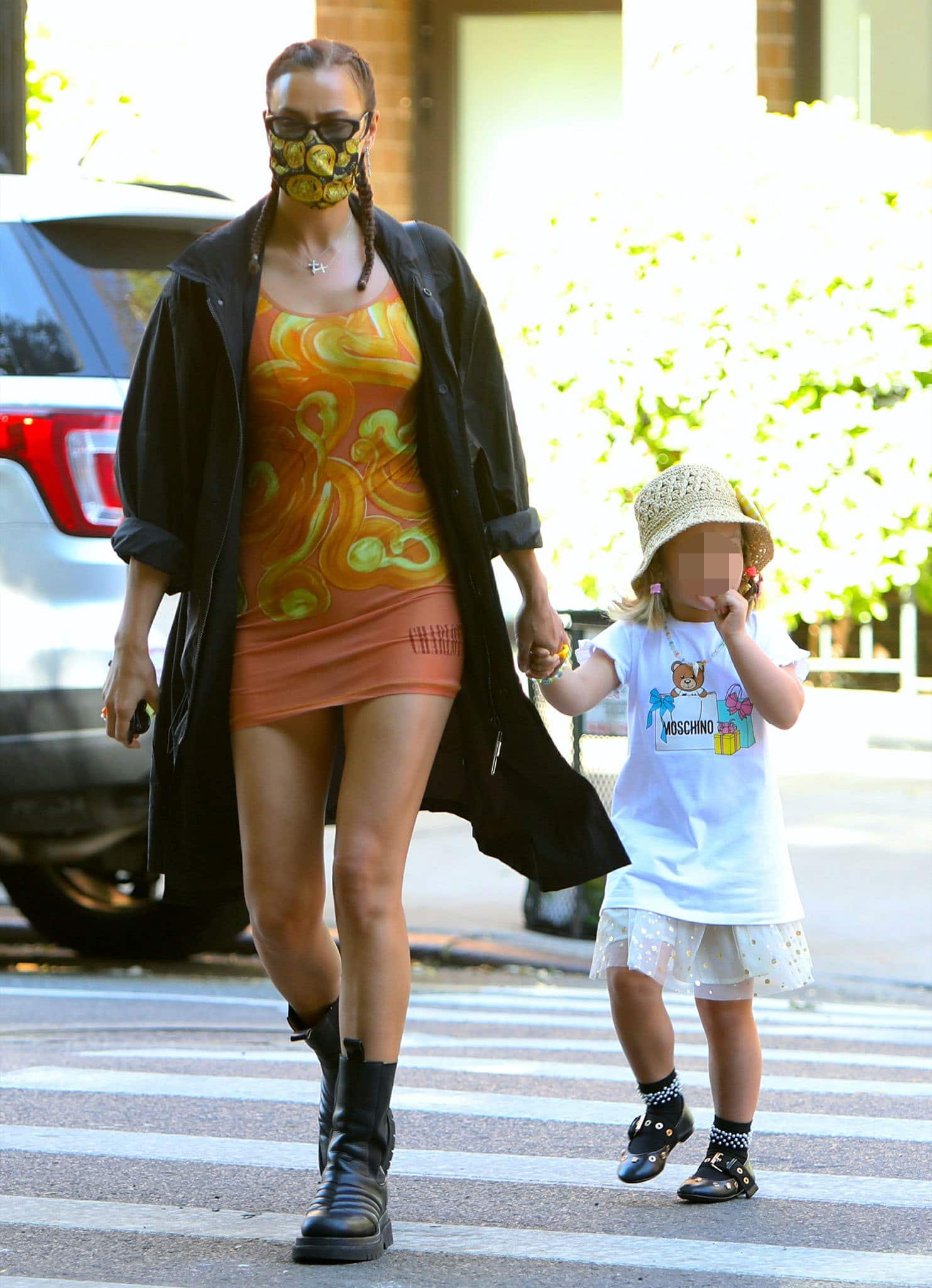 Irina Shayk strolls with Lea in Charlotte Knowles stretch jersey dress and 032C long parka