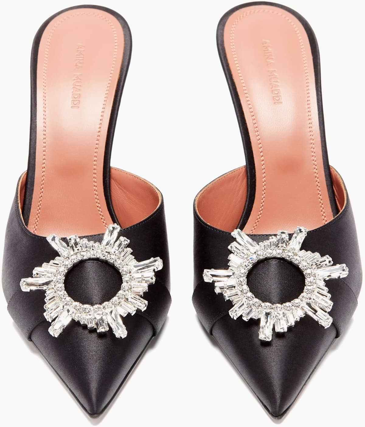 Amina Muaddi's black Begum mules are embellished with crystal buckles for an opulent mood