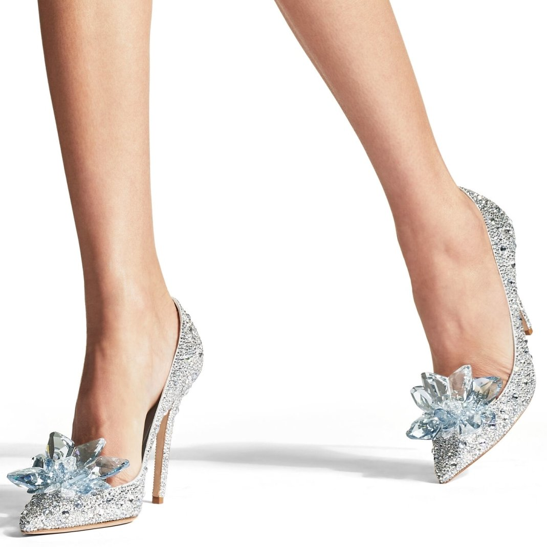 Layered from toe to heel in luxurious Swarovski crystals, this classic pointy toe pump from Jimmy Choo features a dramatic spike heel