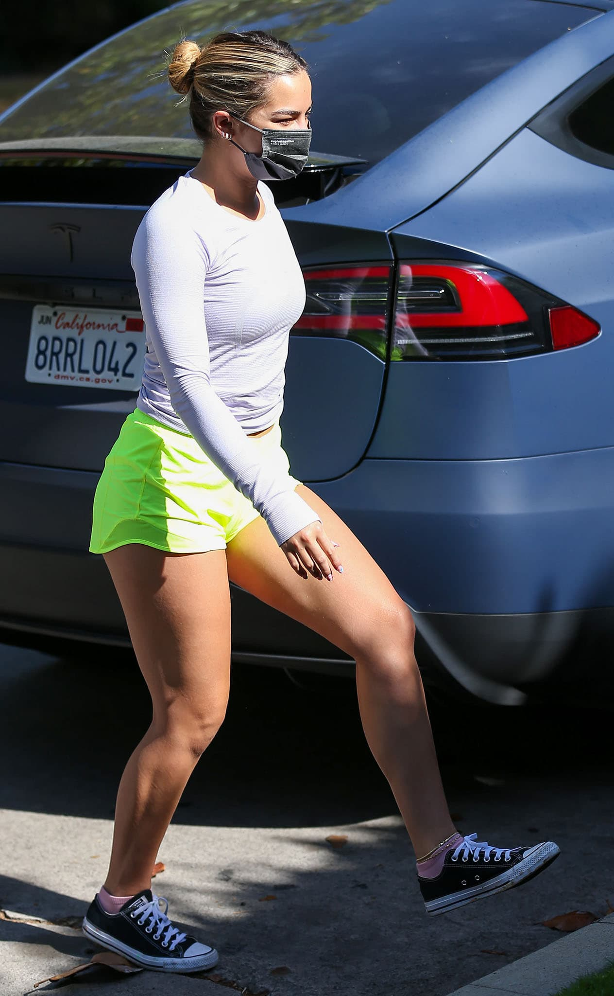 Addison Rae flaunts her curves in Lululemon sweater and highlight yellow high-rise shorts