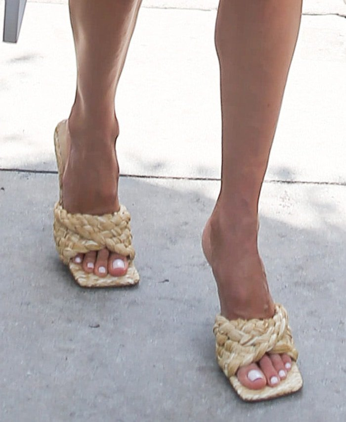 Alessandra Ambrosio completes her chic summer look with Bottega Veneta raffia slide sandals