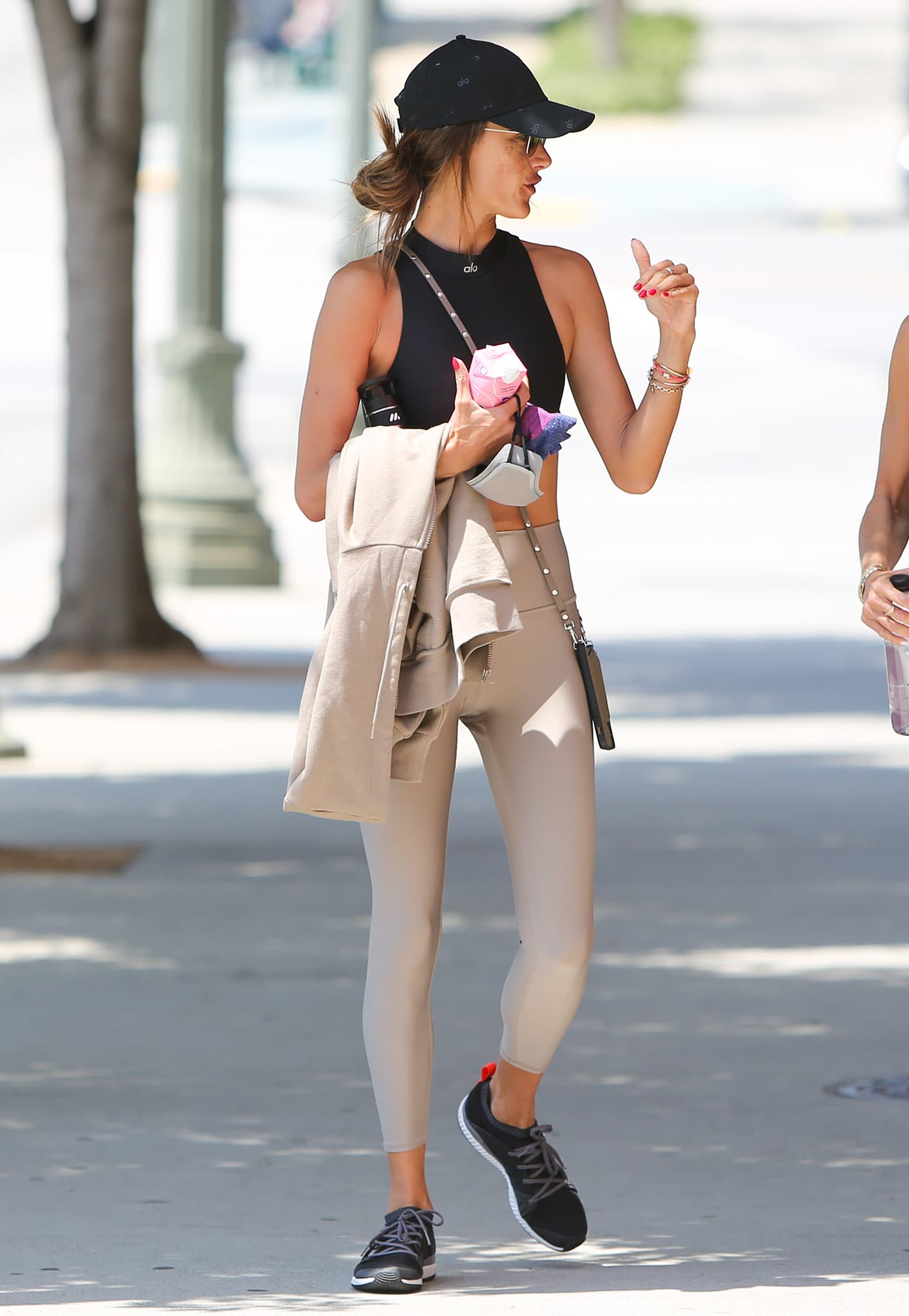 Alessandra Ambrosio goes to gym in Alo Yoga crop top and leggings on June 3, 2021