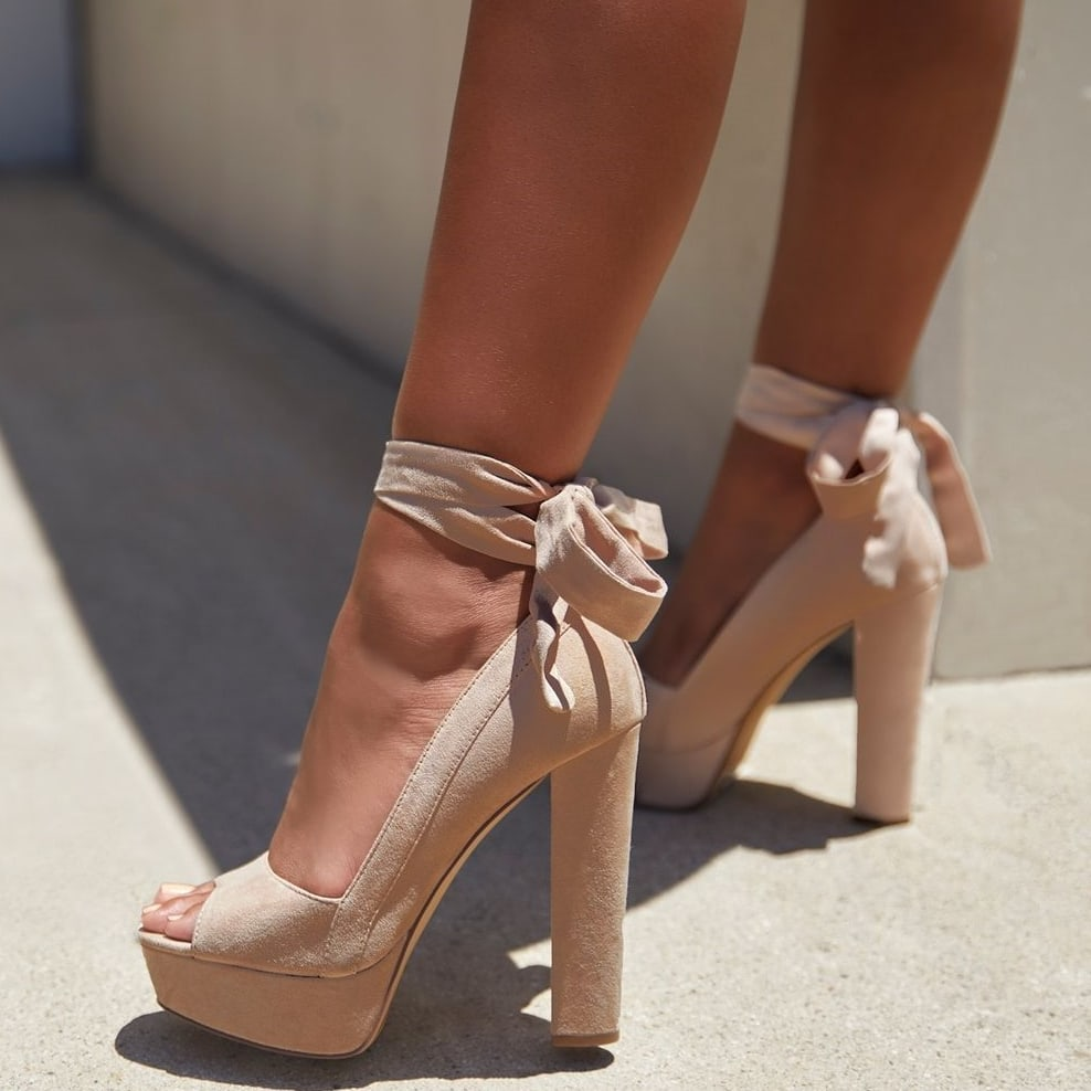 A linen block-heeled pump with wraparound ankle ties