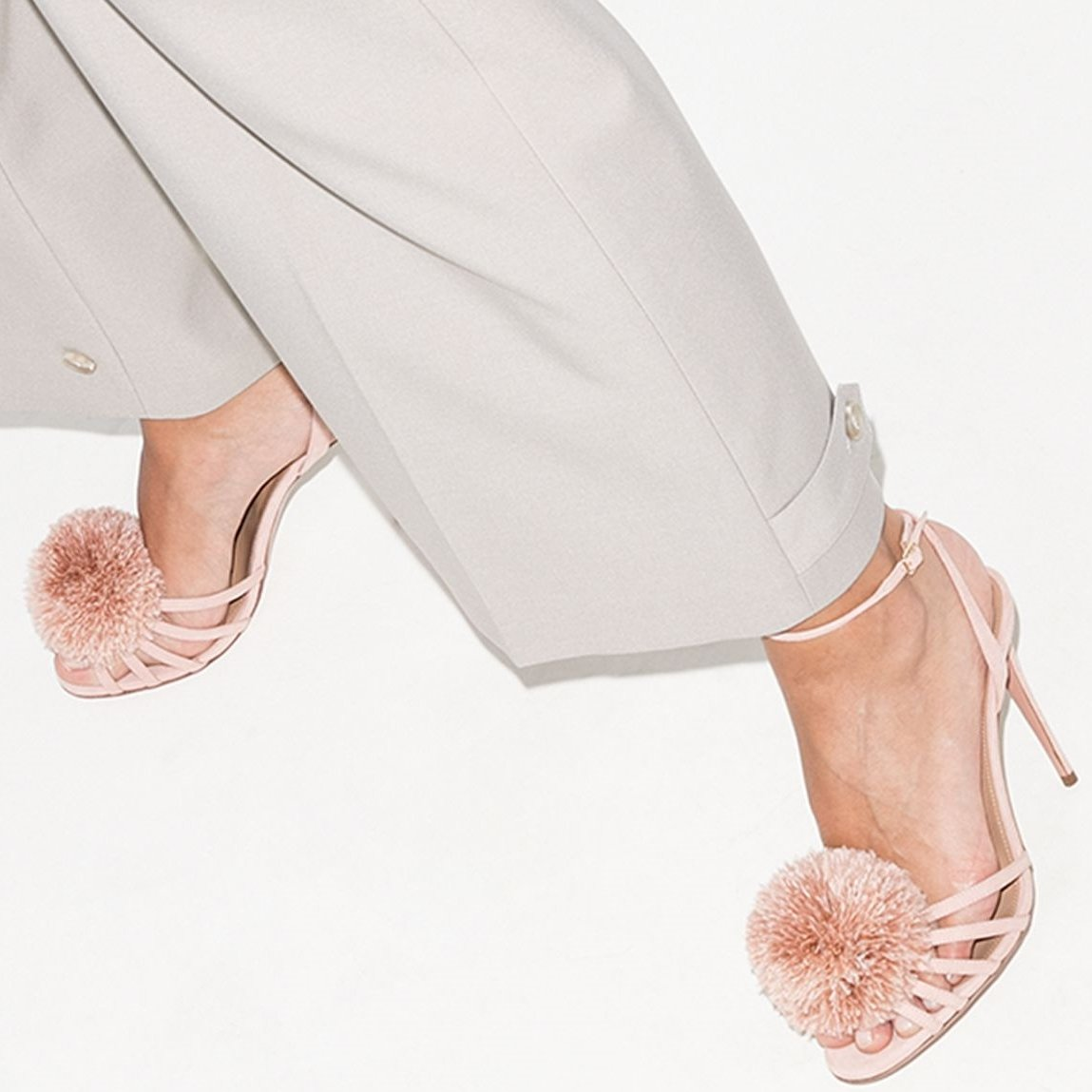 These pink Aquazzura X Browns 50 120 pom-pom leather sandals have been made in Italy