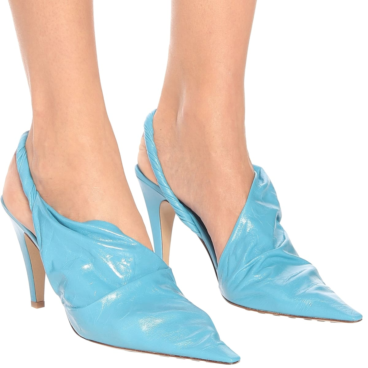 The avant-garde BV Point pumps are made from a single piece of sky blue lambskin leather with contoured vamps and exaggerated point toes