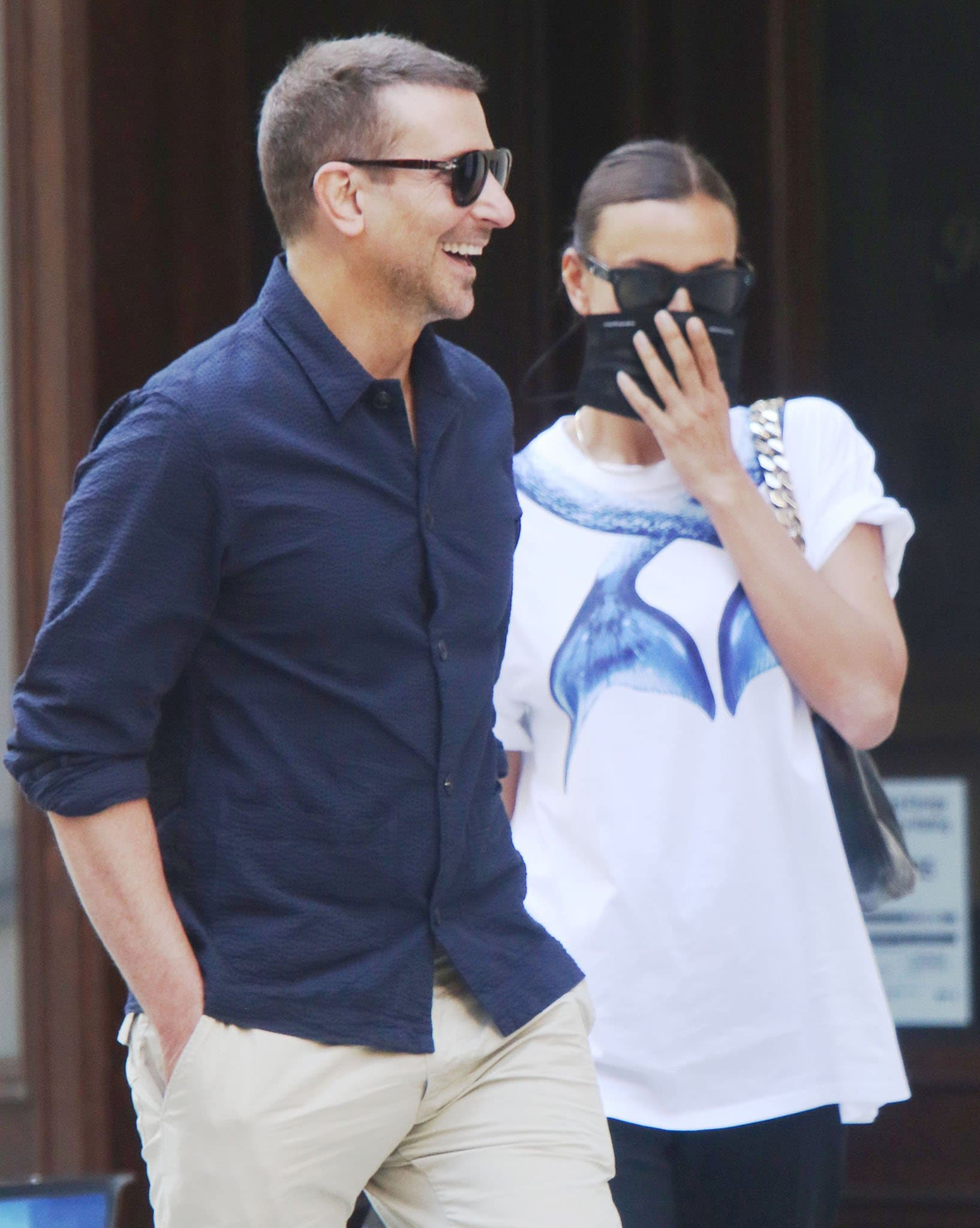 Irina Shayk wears a sleek bun and hides her face behind her Celine sunglasses and face mask