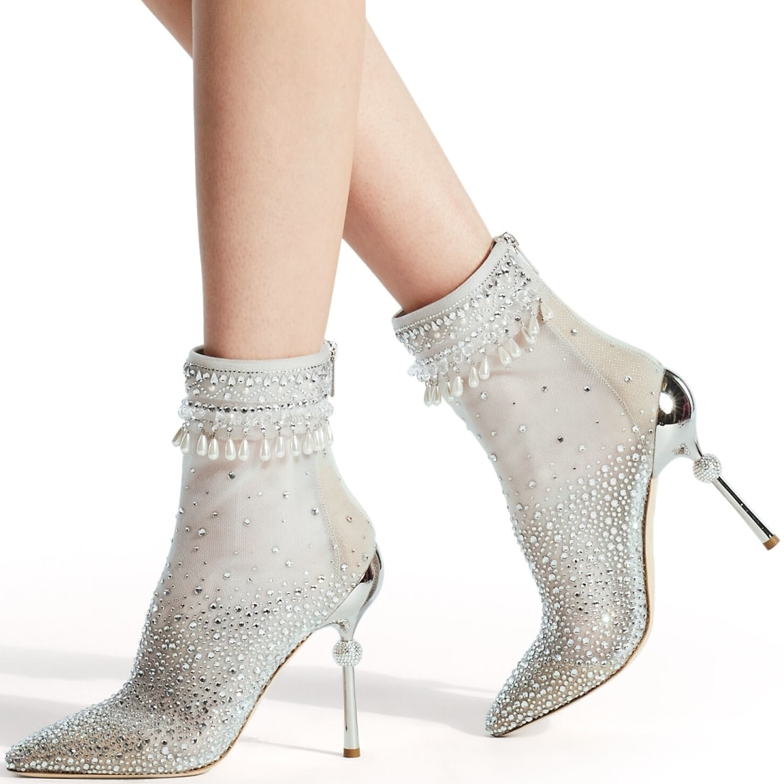 The Cynosure sock booties are made from a fine transparent thread and adorned with a cascade of hotfix crystals in addition to crystal and pearl drop embroidery around the top edge of the boot