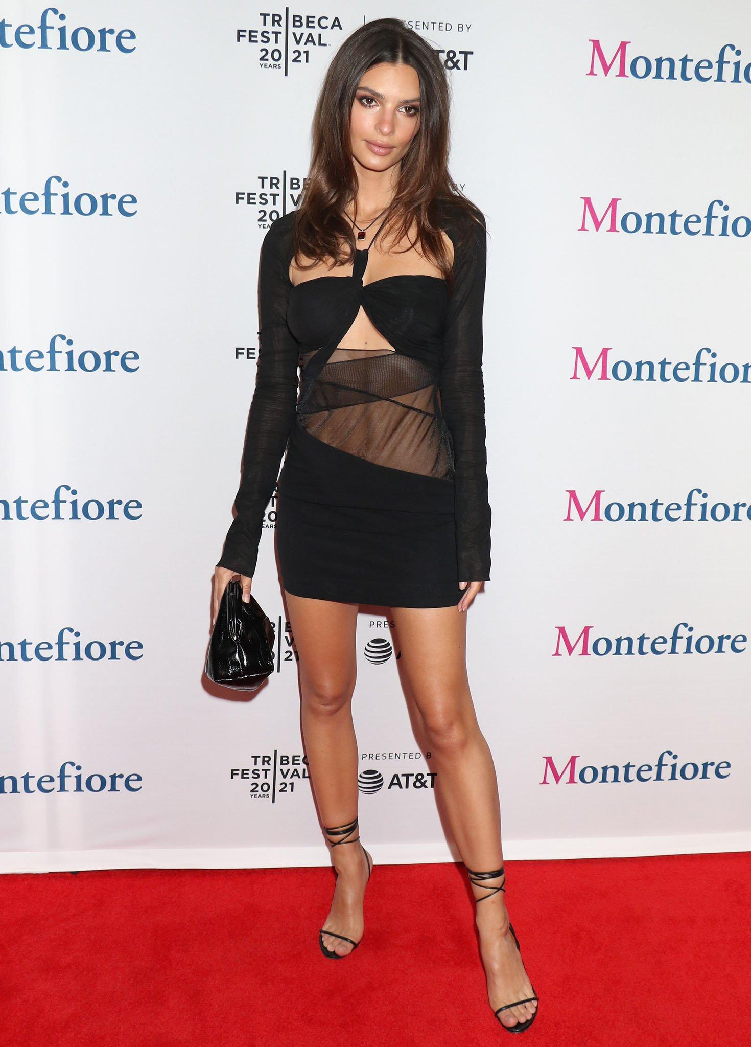 Emily Ratajkowski shows off her slim figure in a Nensi Dojaka sheer mesh mini dress