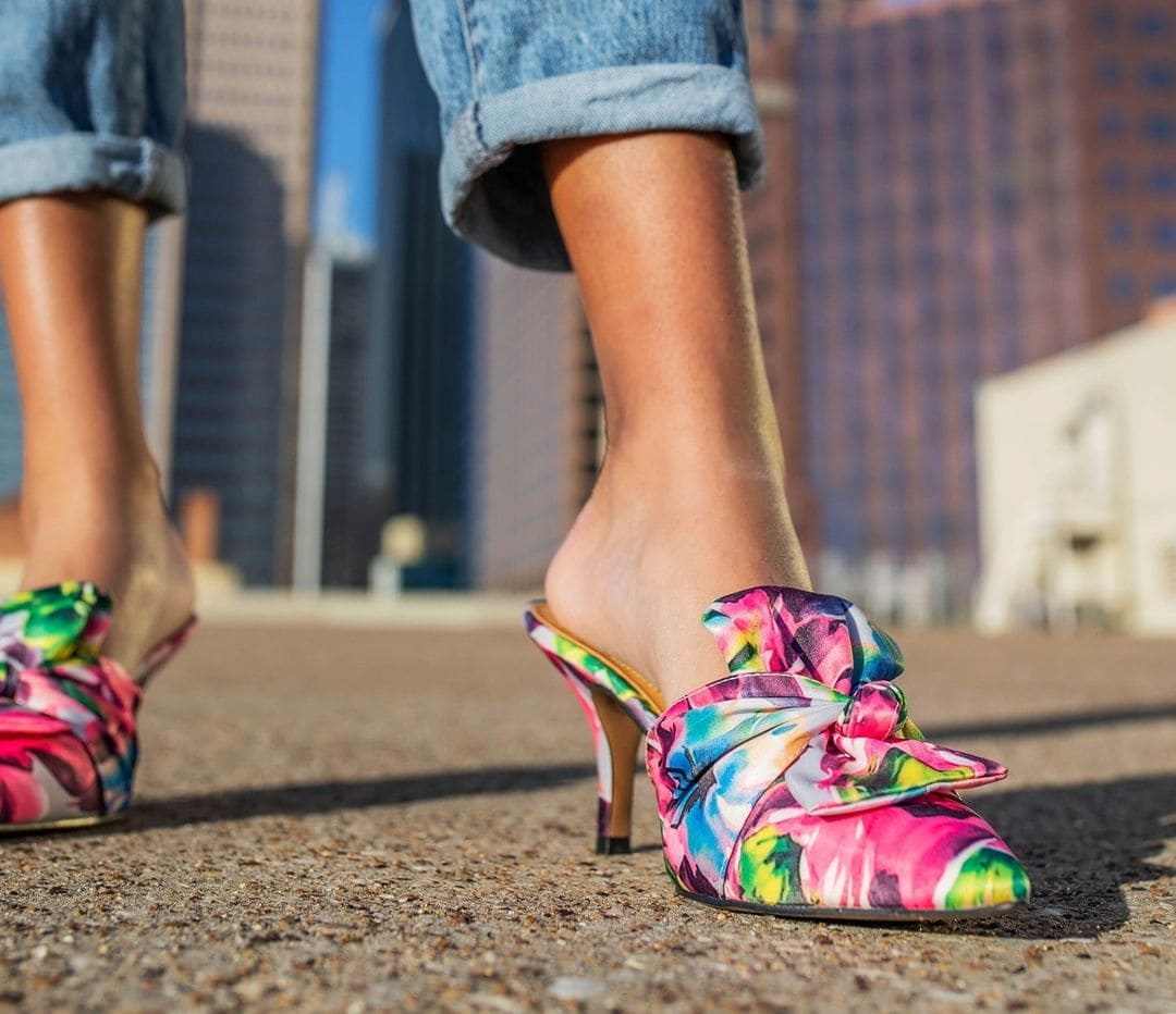 Stand out from the crowd this season wearing the colorful floral print J. Renee Mianna pumps