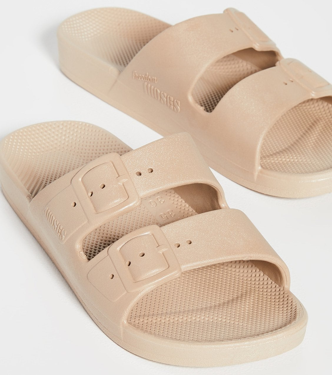 Freedom Moses' Moses slides are vegan and waterproof and have the signature milk and honey scent