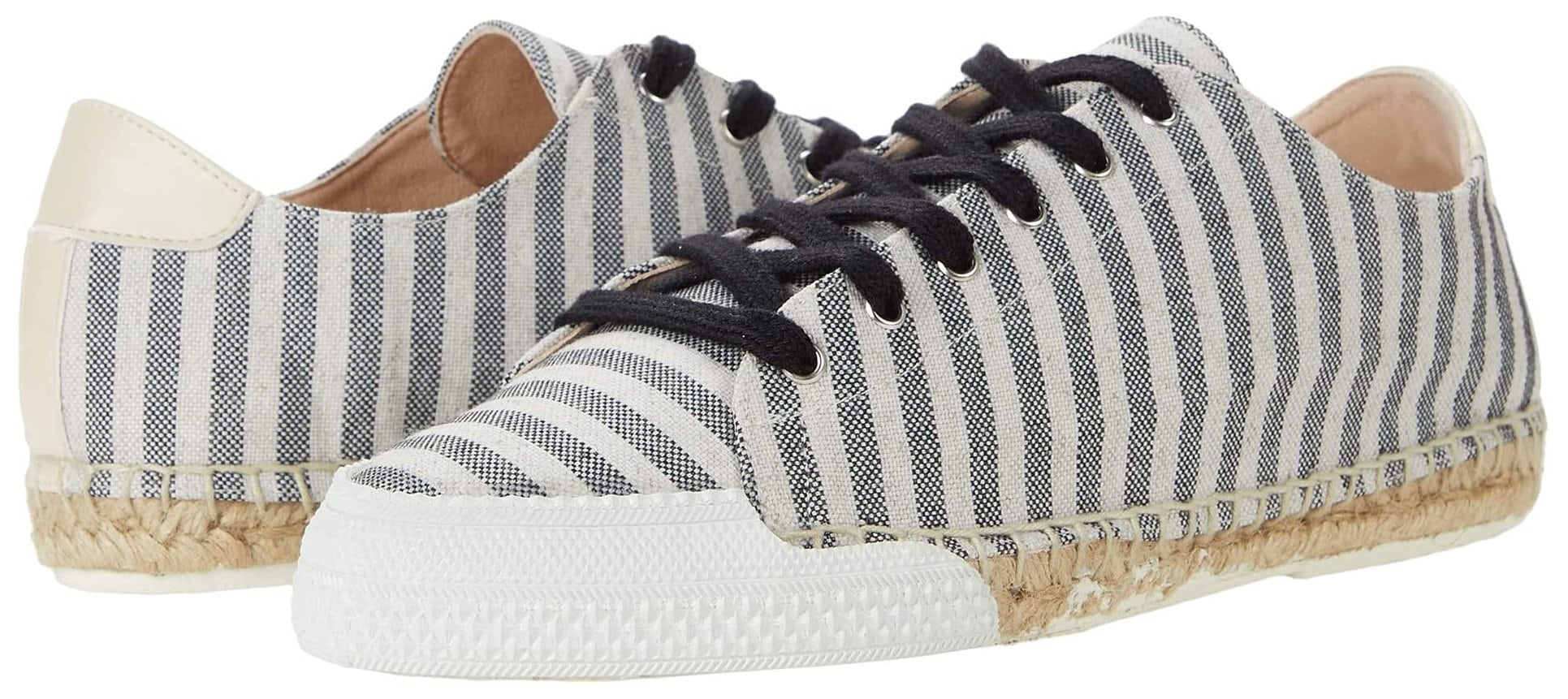 A handcrafted and hand-dyed espadrille sneaker with a lace-up closure and a jute-wrapped sole