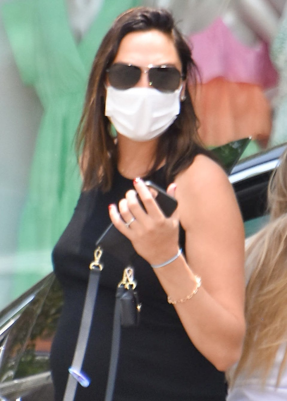 Gal Gadot keeps a low profile with a pair of aviators and a white face mask