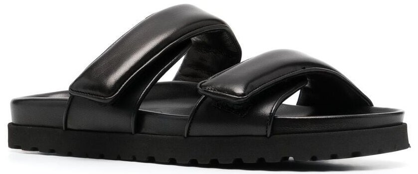 A comfortable pair of slides with smooth padded leather straps