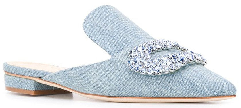 A simple pair of denim mules jazzed up with a large crystal buckle accent