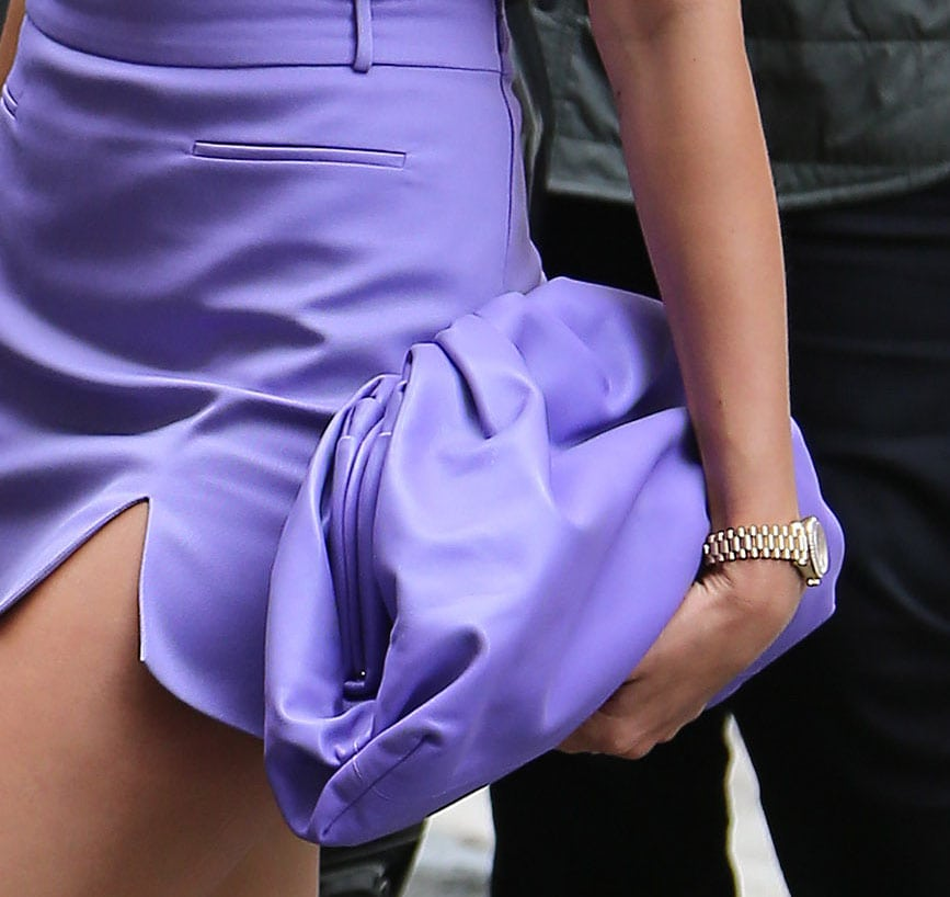 Hailey Bieber coordinates her outfit with her Bottega Veneta purple pouch