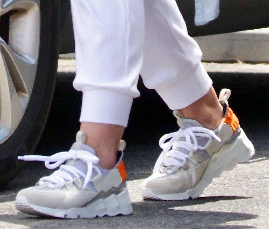 Hilary Duff finishes off her chic gym outfit with Pierre Hardy Trek Comet sneakers