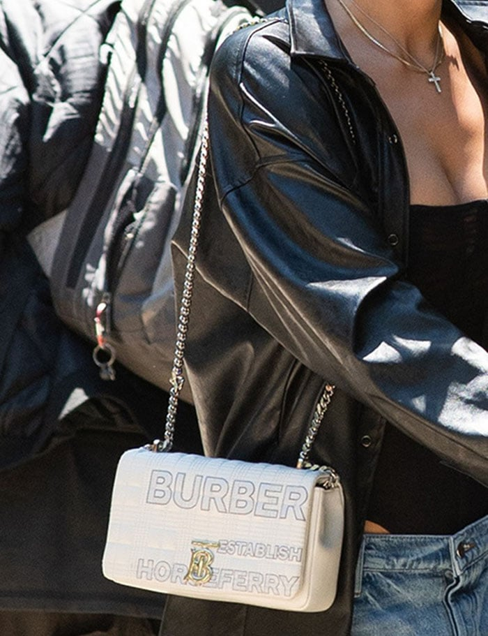 Irina Shayk carries her essentials in Burberry Horseferry-print white quilted bag