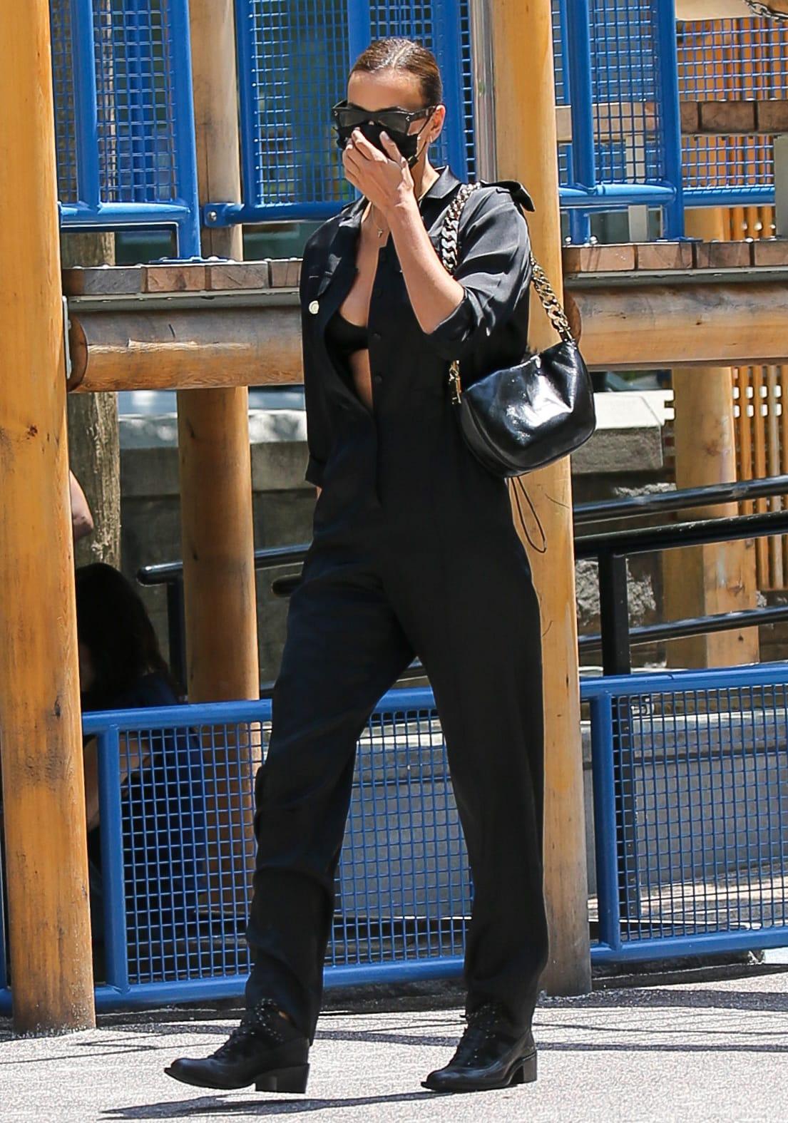 Irina Shayk looks chic in her easy and elegant Burberry black jumpsuit