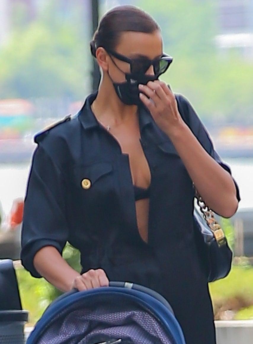 Irina Shayk keeps it low-key with Celine Tilda sunglasses and Naked Cashmere x EvolveTogether face mask