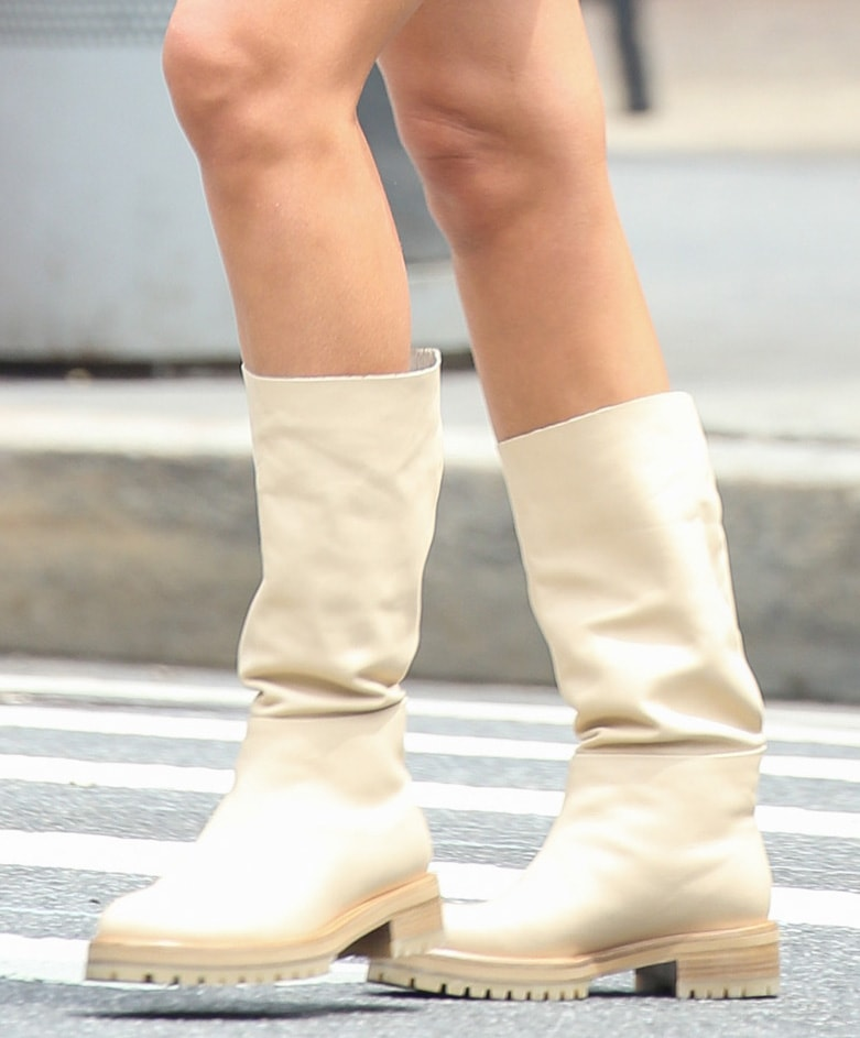 Irina Shayk completes her neutral-themed outfit with beige summer boots from her collaboration with Tamara Mellon