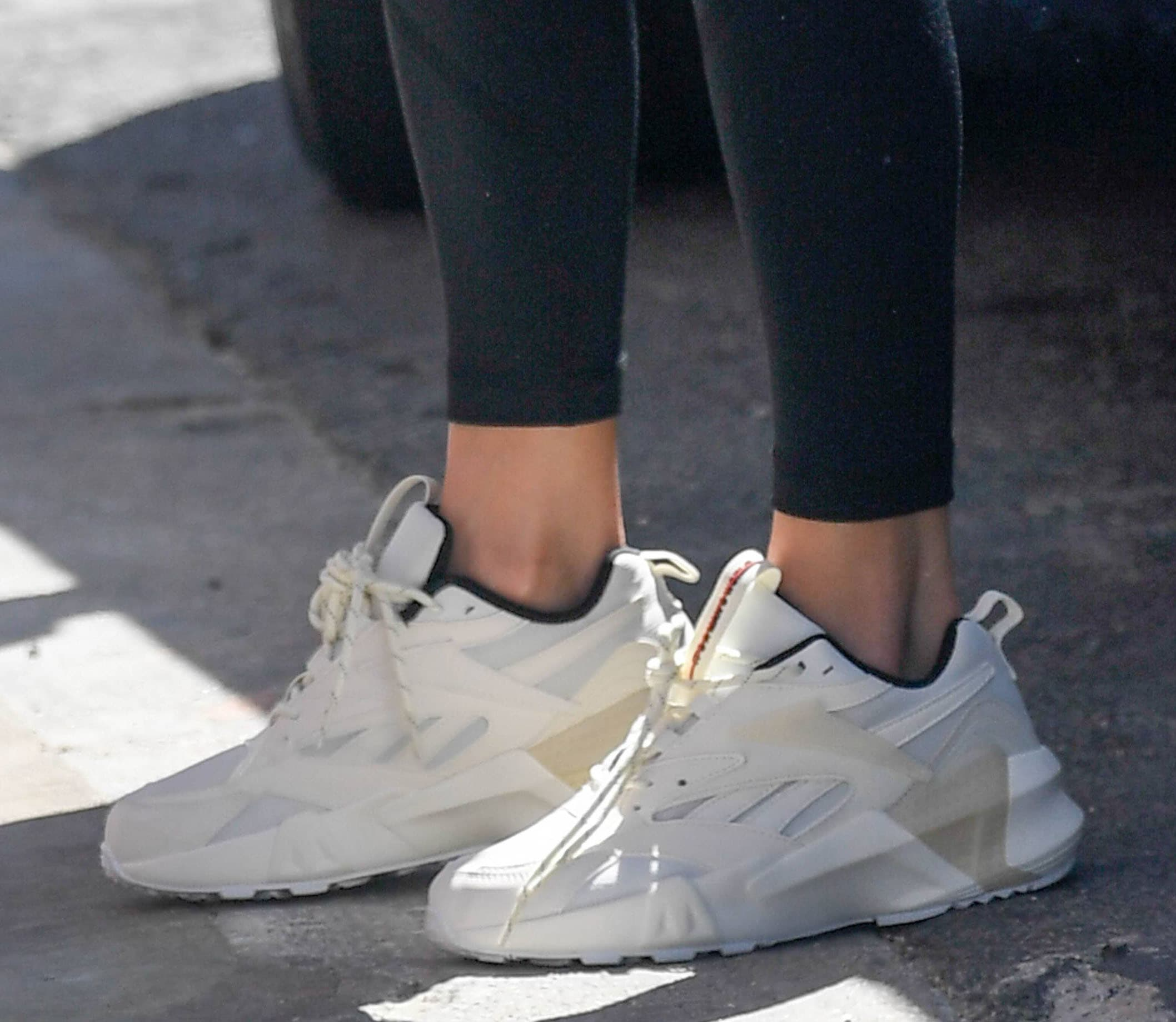 Jennifer Lopez completes her athletic outfit with Reebok Aztrek Man's World chunky white sneakers