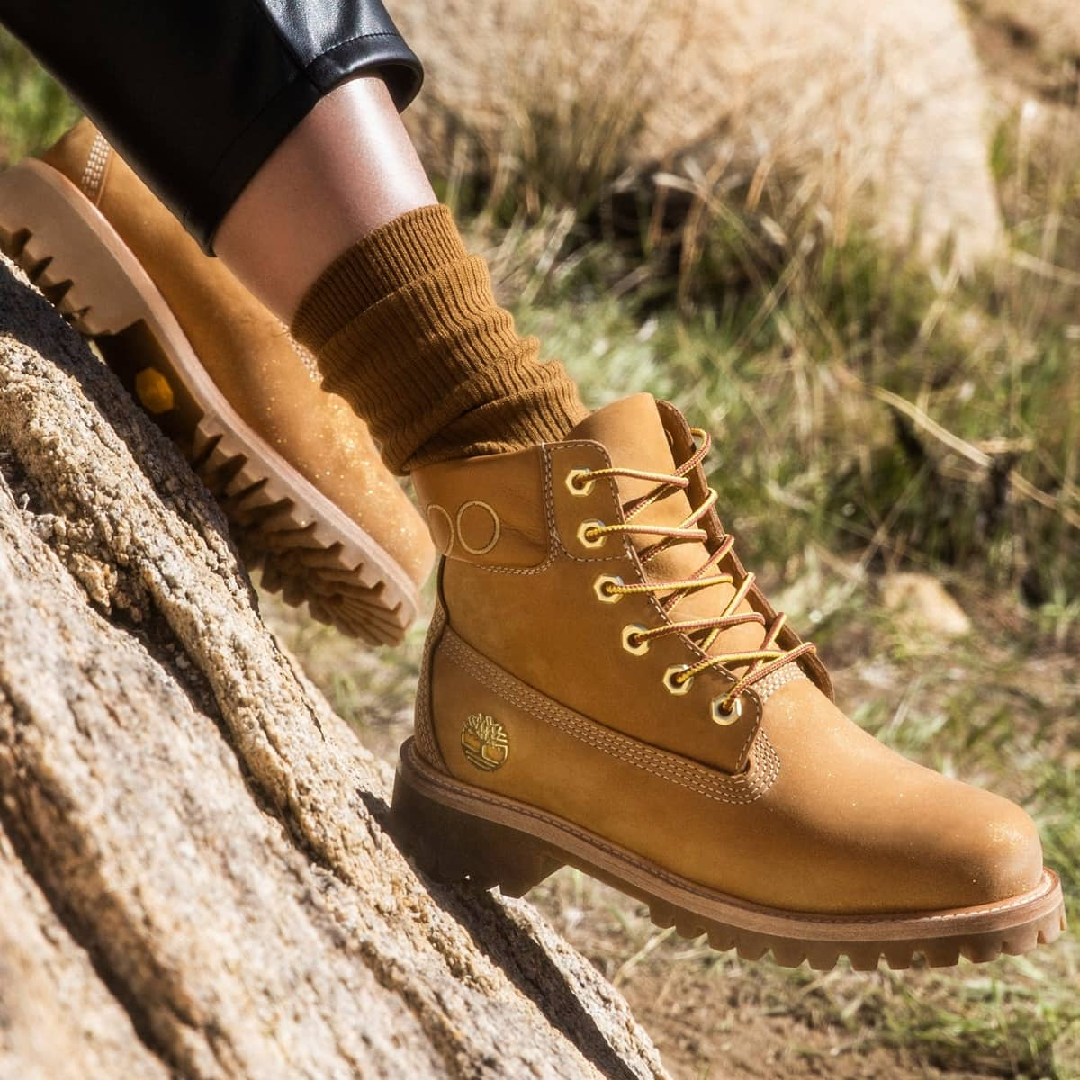 This leather-lined sustainably-made boot is grounded with durable Vibram outsoles and sprayed with gold glitter