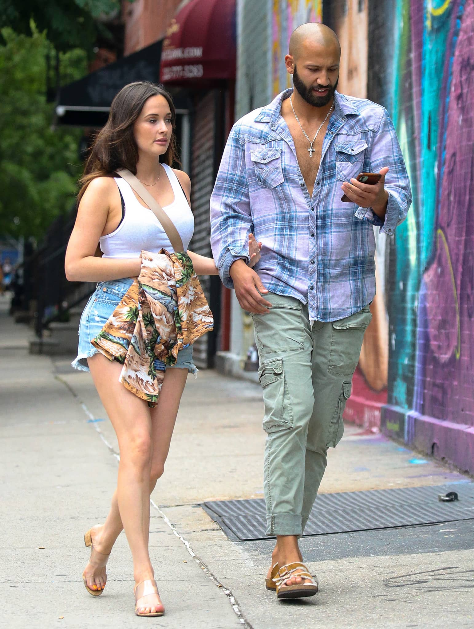 Kacey Musgraves looks hot in white tank top and daisy dukes on a dinner date with Cole Schafer on June 18, 2021
