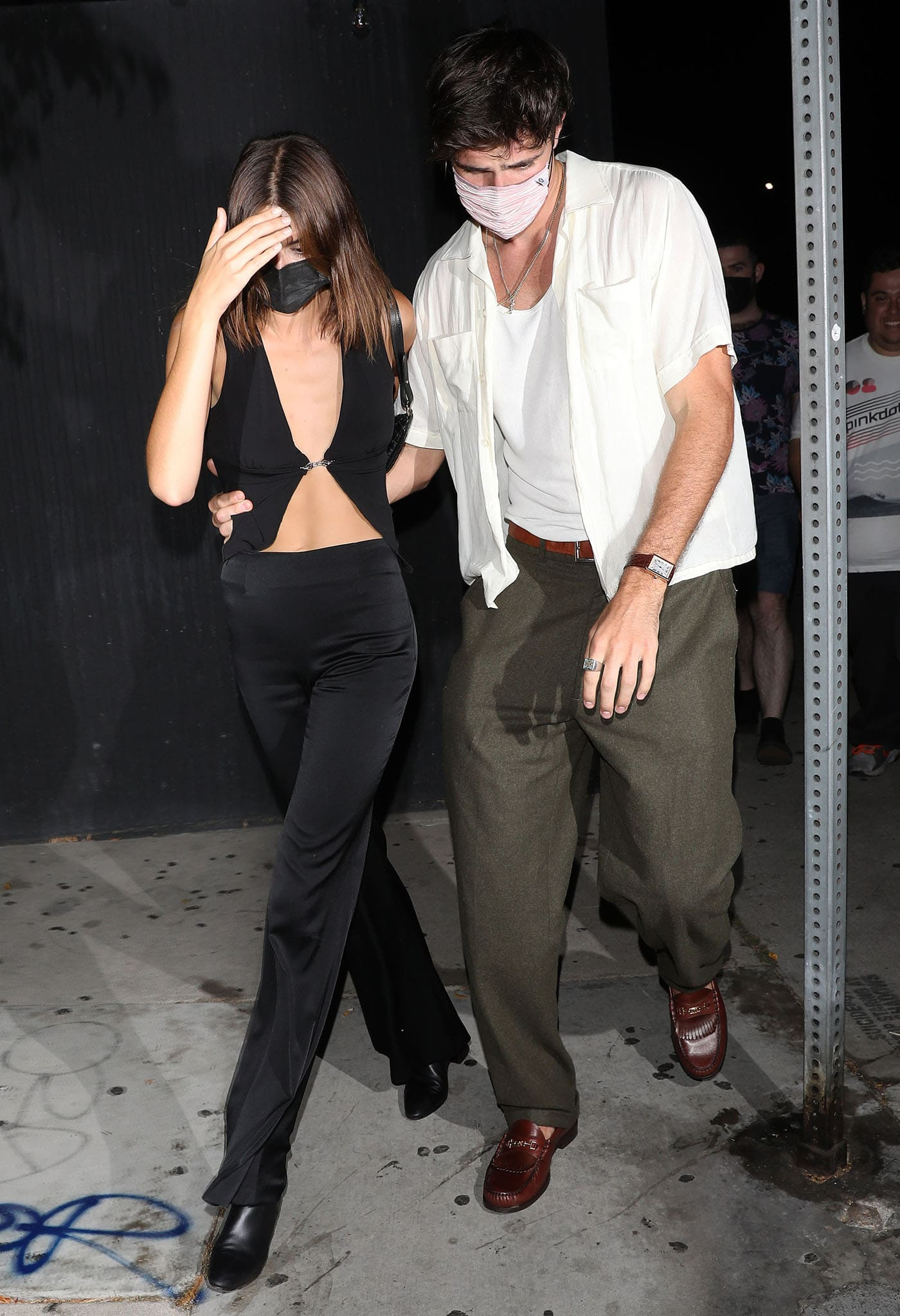 Braless Kaia Gerber shows off her cleavage and abs in a tiny crop top from I.Am.Gia with Galvan high-rise pants
