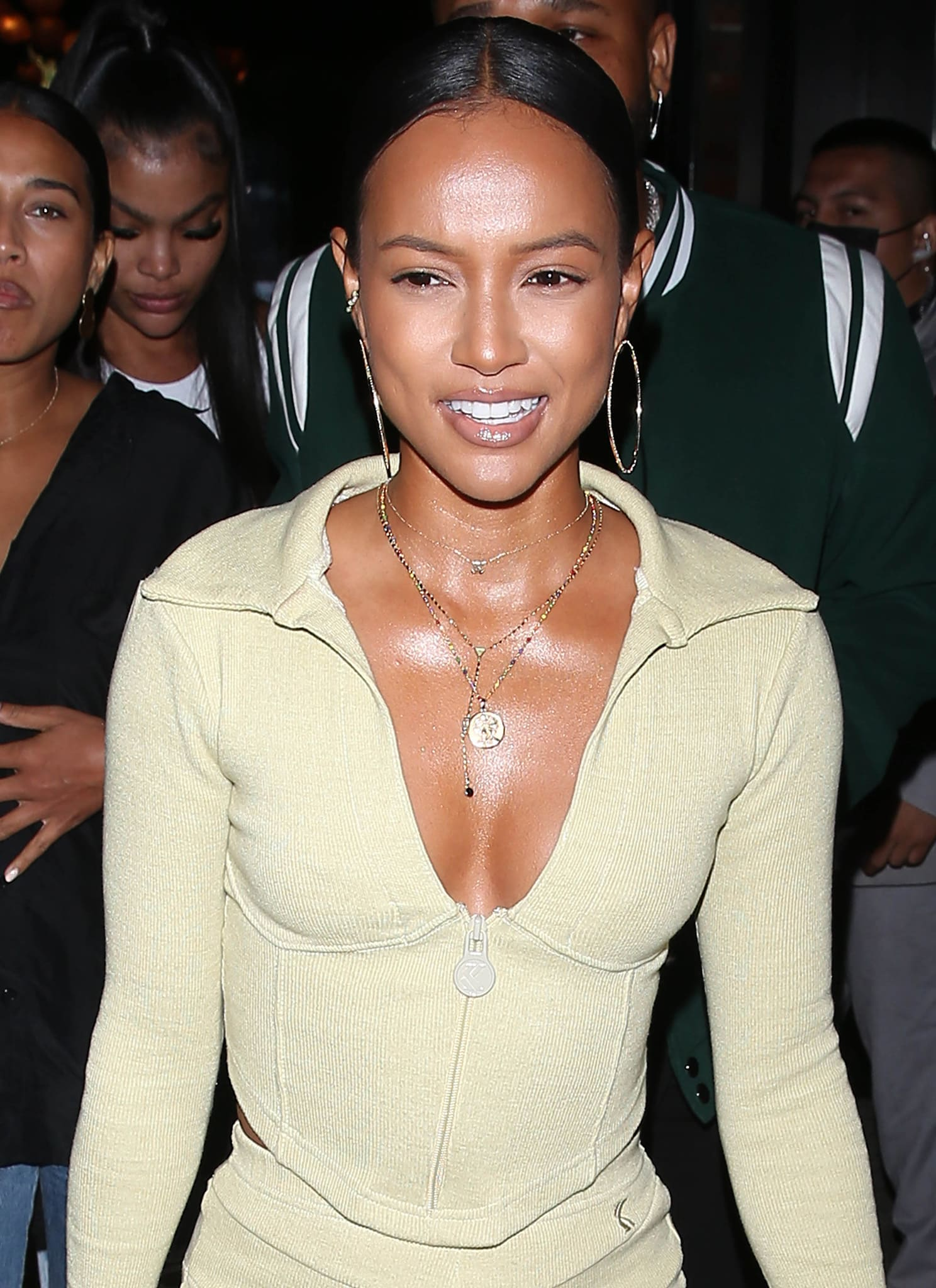 Karrueche Tran draws attention to her cleavage with layered necklaces