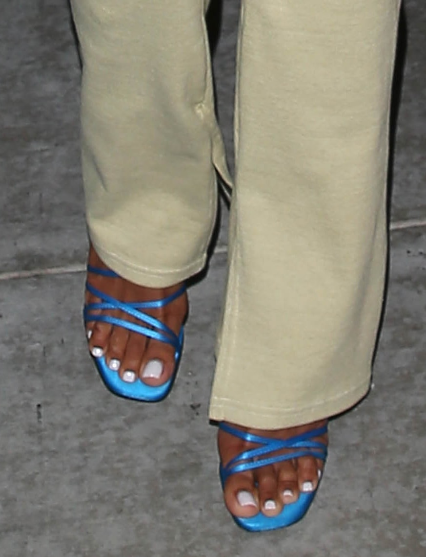Karrueche Tran adds a chic contrast to her look with blue Fiona sandals from Attico