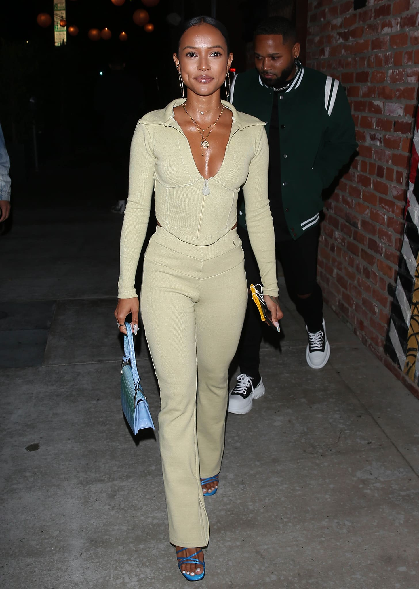 Karrueche Tran shows off her cleavage in a sporty ribbed collared top and matching pants