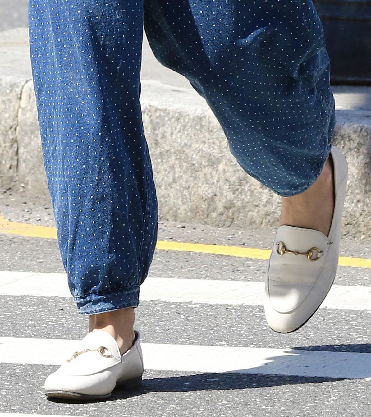 Katie Holmes completes her summer boho look with white Gucci Brixton collapsible-heel leather loafers