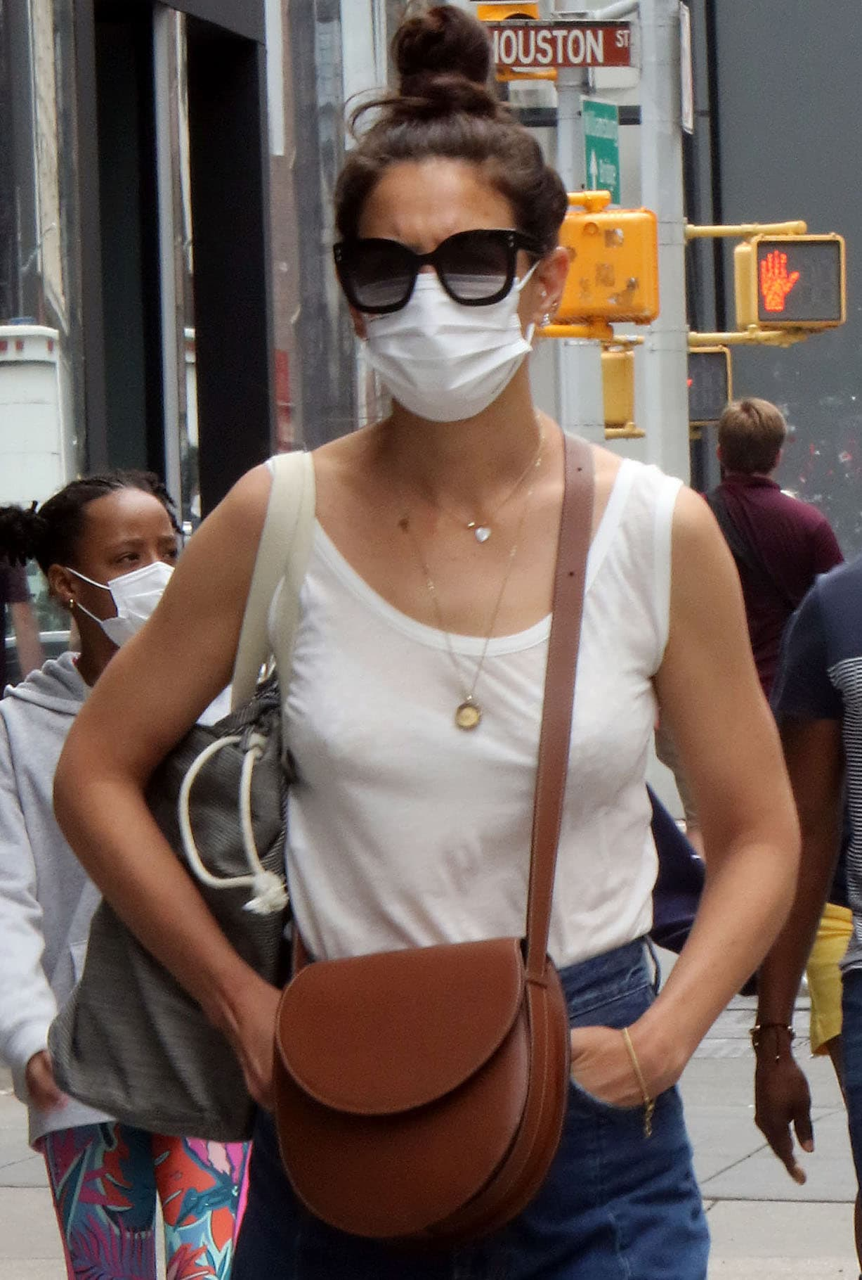 Katie Holmes wears her hair up in a casual bun as she shields her eyes behind a pair of Isabel Marant Trendy sunglasses