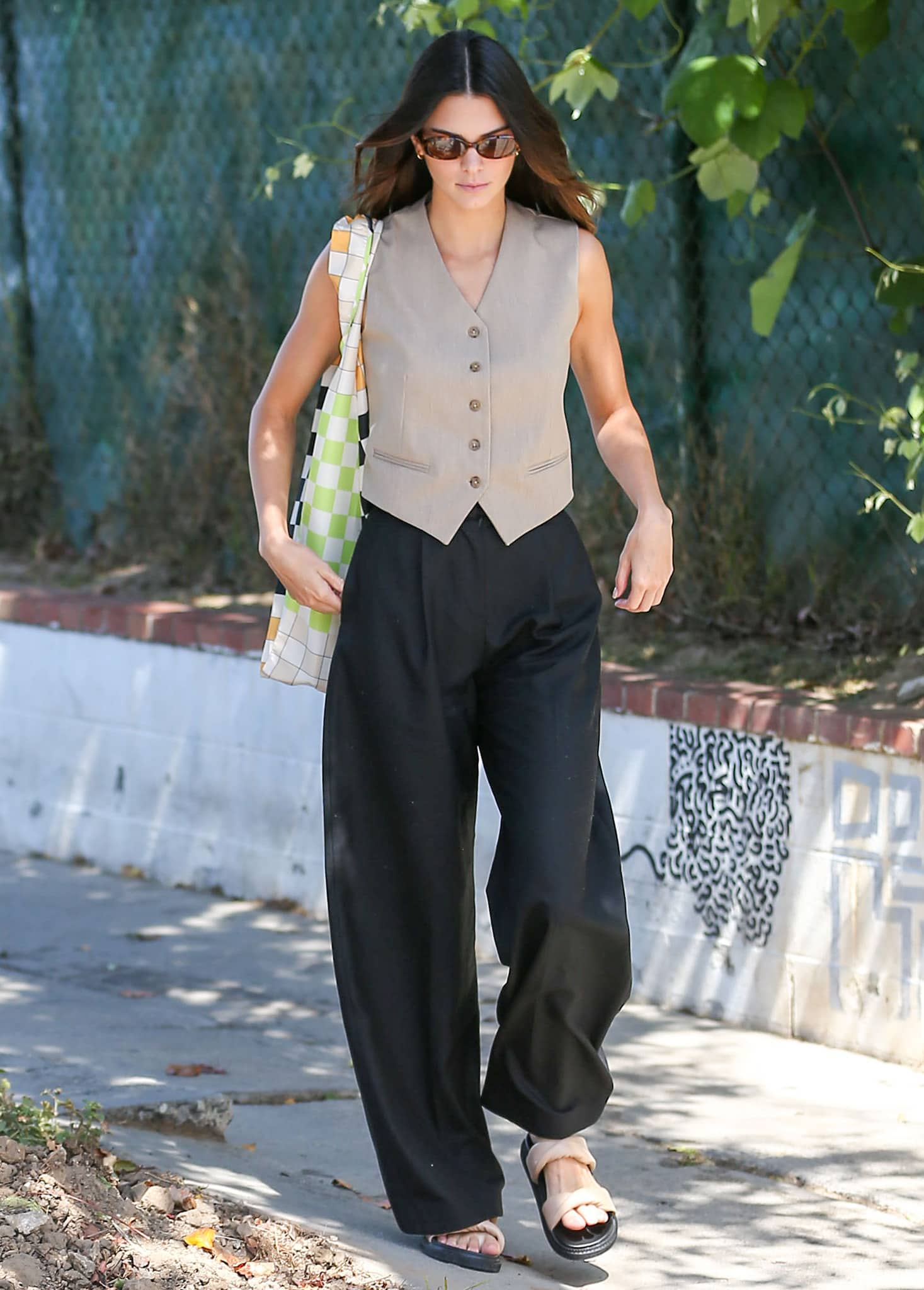 Kendall Jenner borrows from men's fashion with Daniele Alessandrini vest and Fiona O'Neill baggy pants