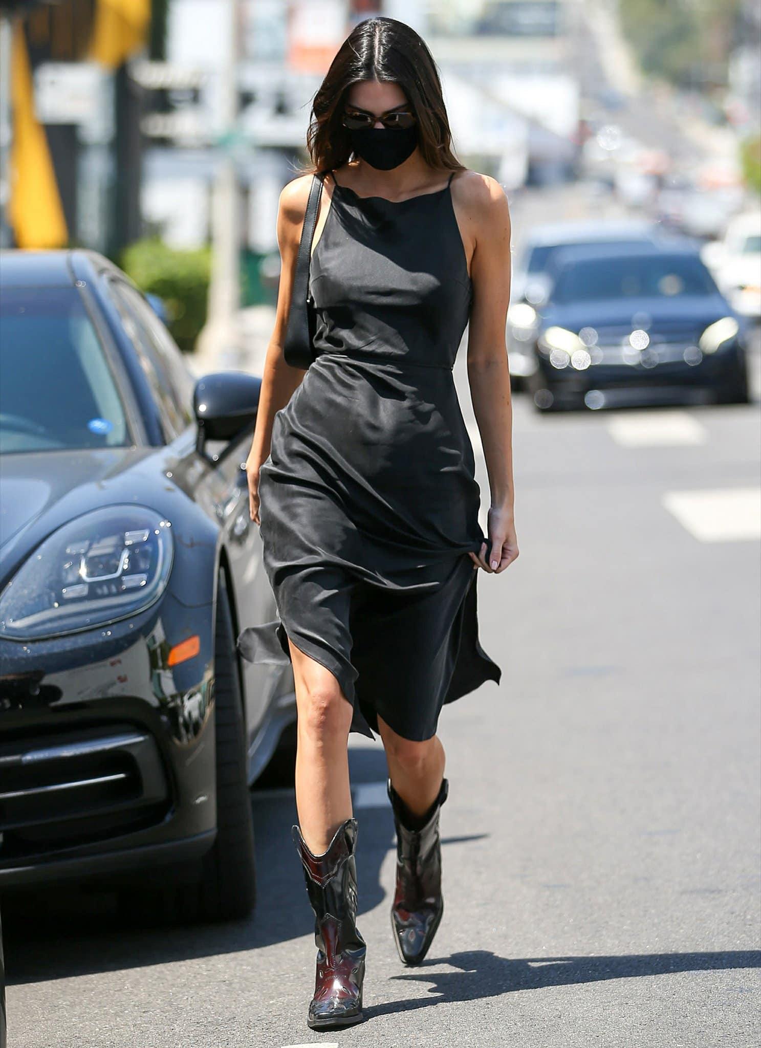 Kendall Jenner flaunts her figure in a slinky LBD