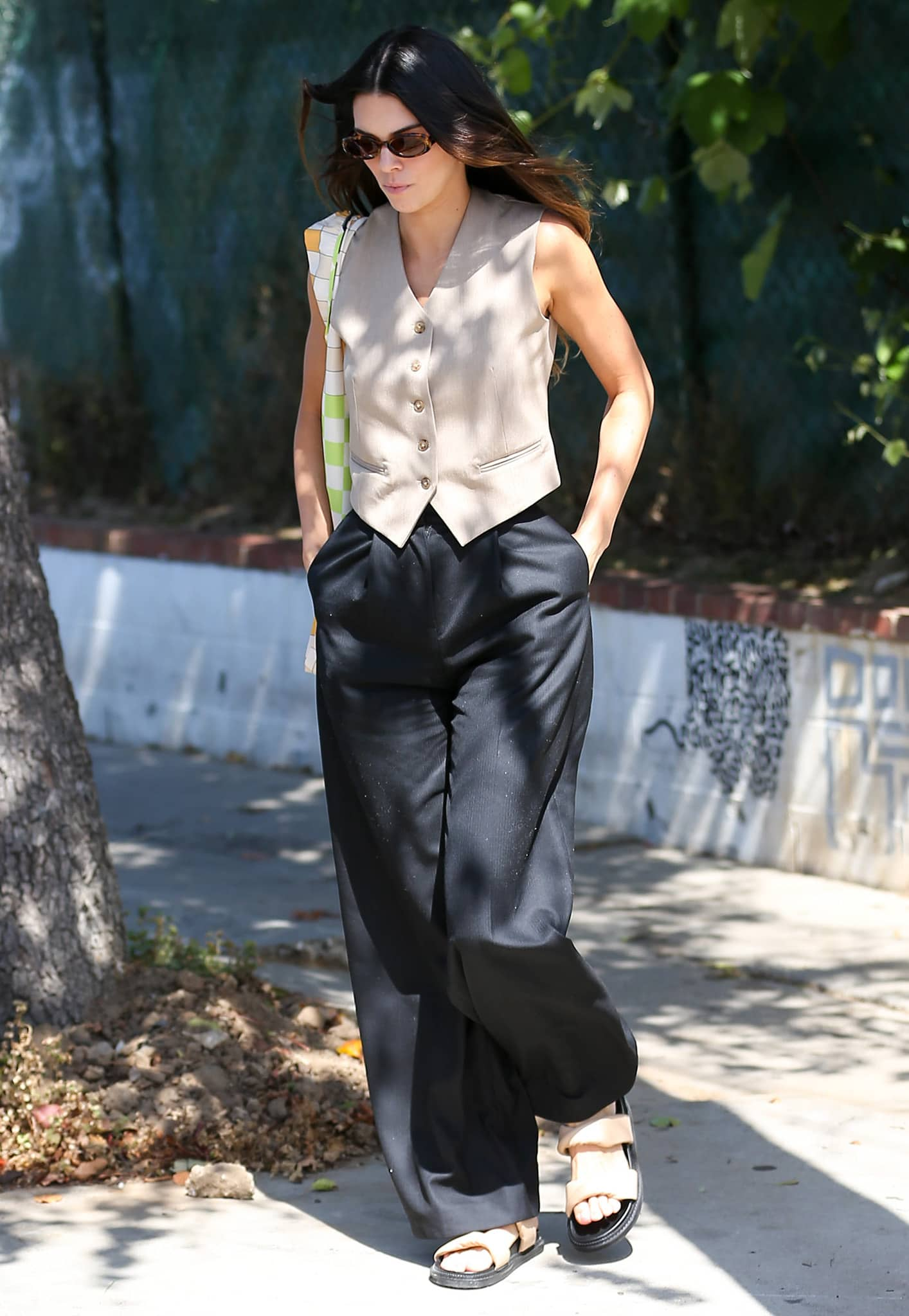 Kendall Jenner channels Chandler Bing while out for lunch in Los Angeles on May 26, 2021