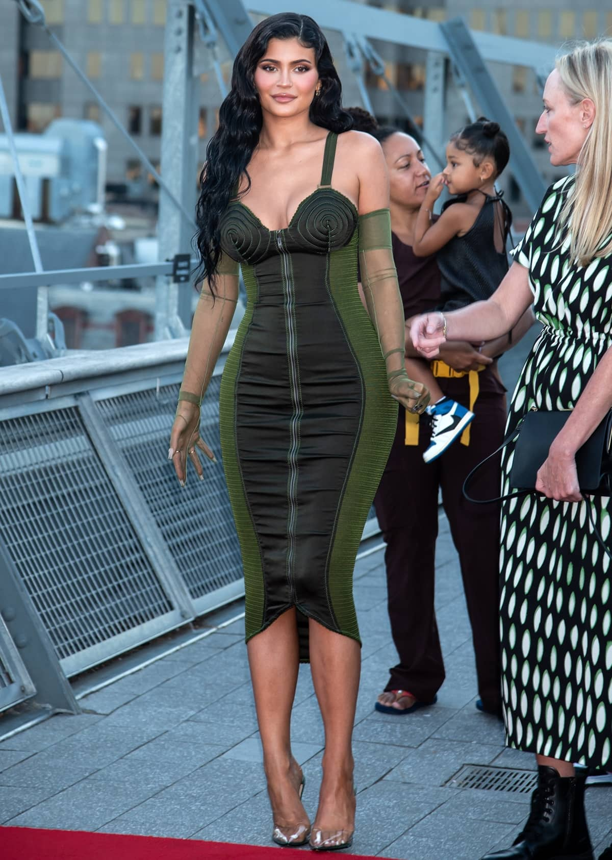 Kylie Jenner arrives in a vintage 1987 Jean Paul Gaultier green sheer bandage cone bra wiggle dress