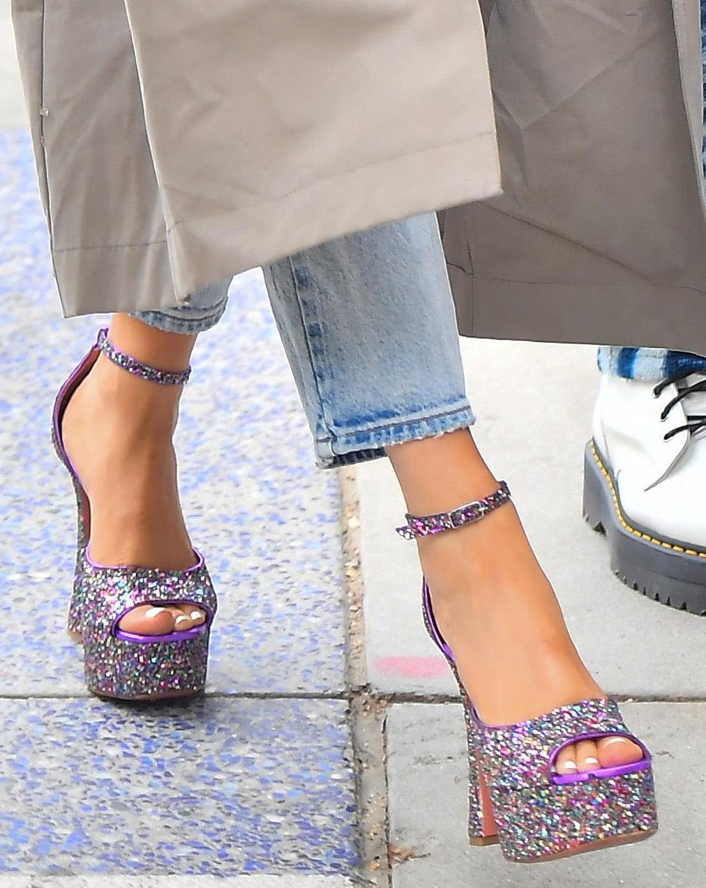 Megan Fox adds sparkle to her outfit with Amina Muaddi Bianca glitter platform sandals