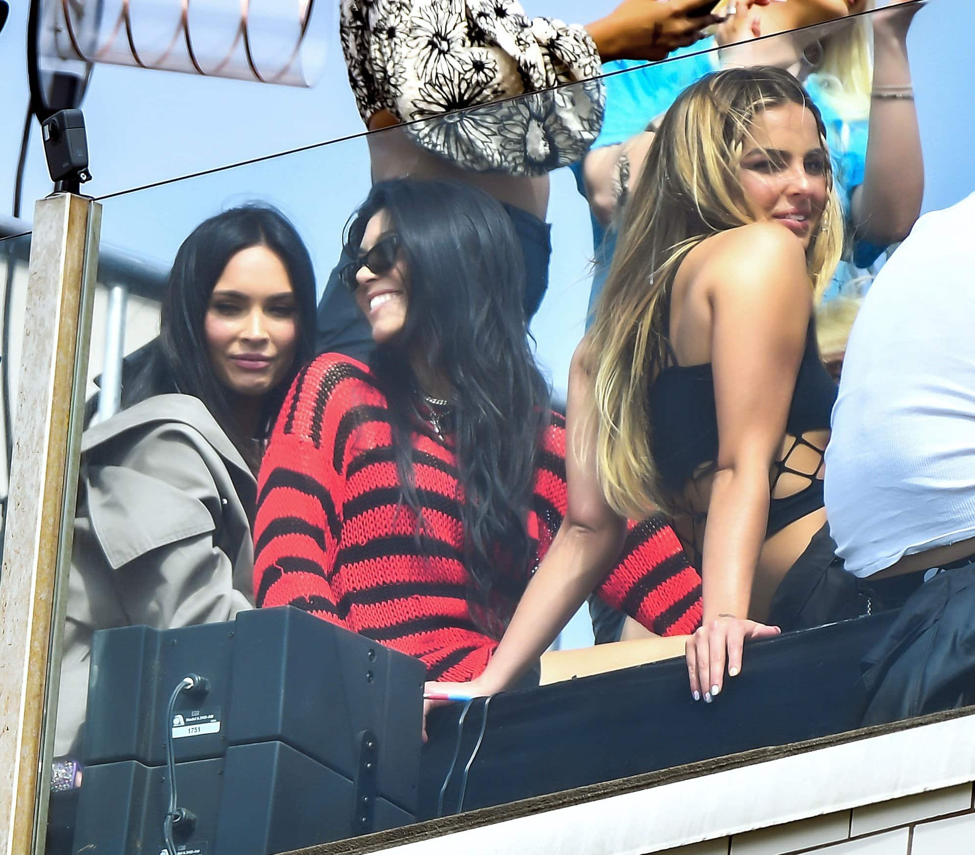 Megan Fox and Kourtney Kardashian show support for their boyfriend's rooftop concert with Addison Rae